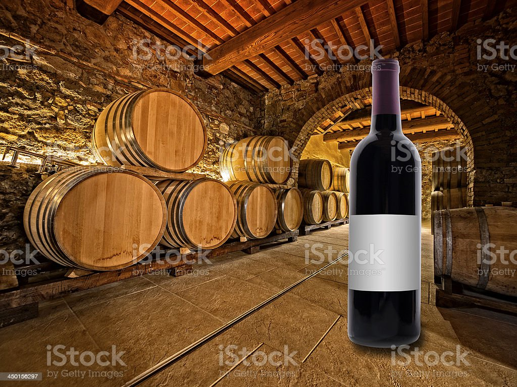 wine bottle and barrels royalty-free stock photo