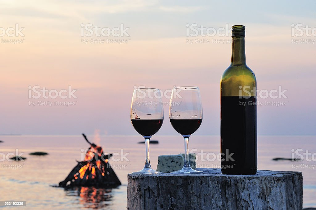 Wine bottle and wine glasses stock photo
