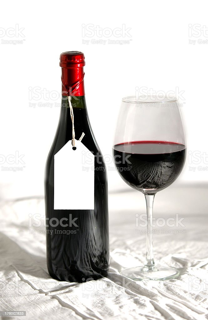 Wine bottle, glass full and empty label stock photo