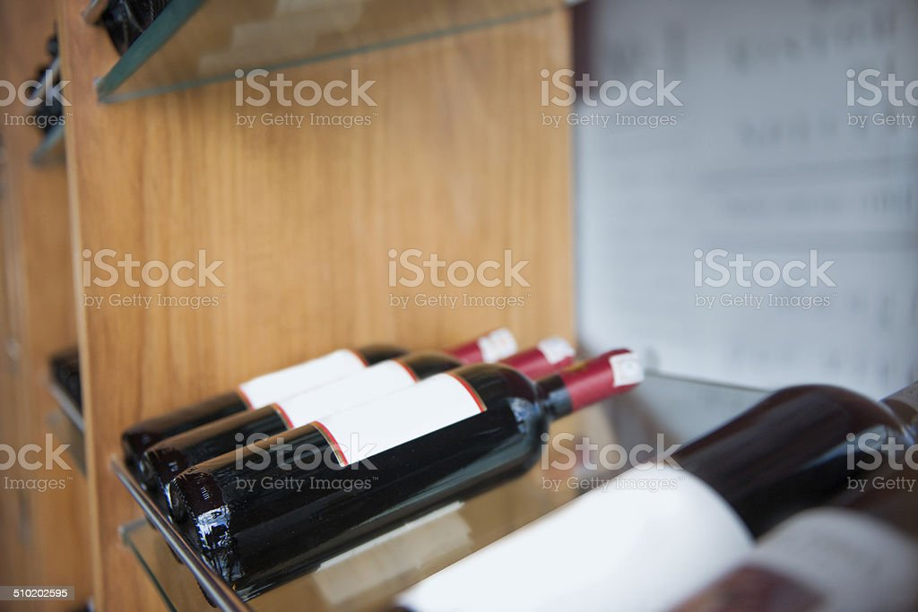 Wine bottle in a row stock photo