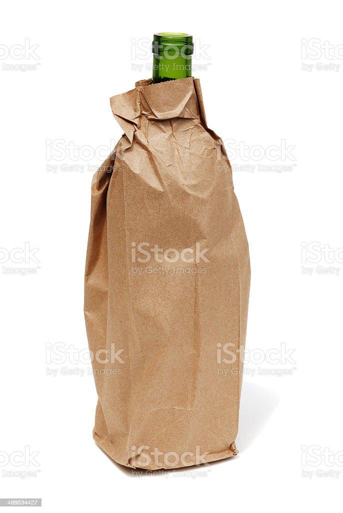 Wine bottle in paper bag stock photo