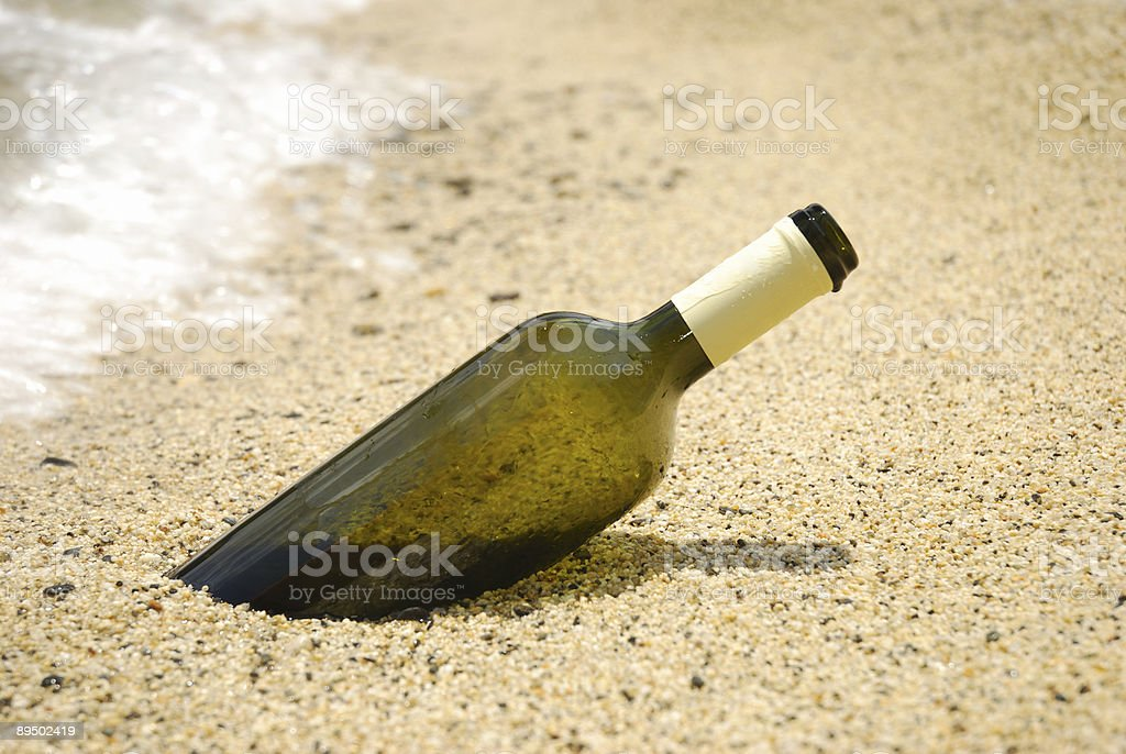 Wine bottle in the sand royalty-free stock photo