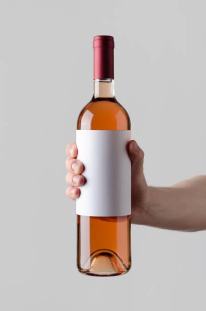 Wine bottle mockup blank label male hands holding a wine bottle on a picture id819716744?b=1&k=6&m=819716744&s=612x612&w=0&h=mu0eewjwig2jwjvoqxn9kpnxazqebcgymcuegqtloim=