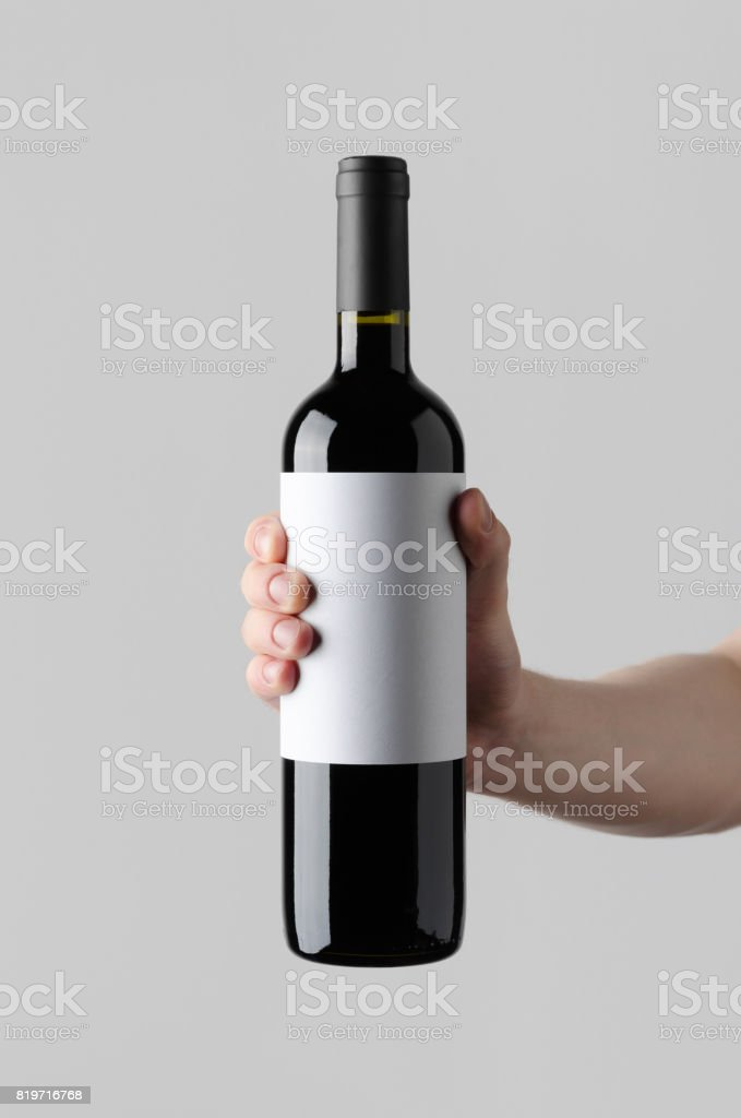 Wine Bottle Mock-Up. Blank Label - Male hands holding a wine bottle...