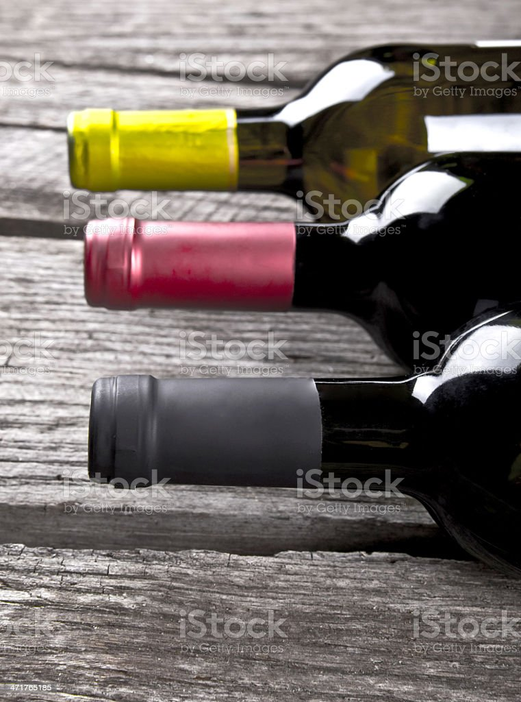 Wine bottle on a wooden table stock photo