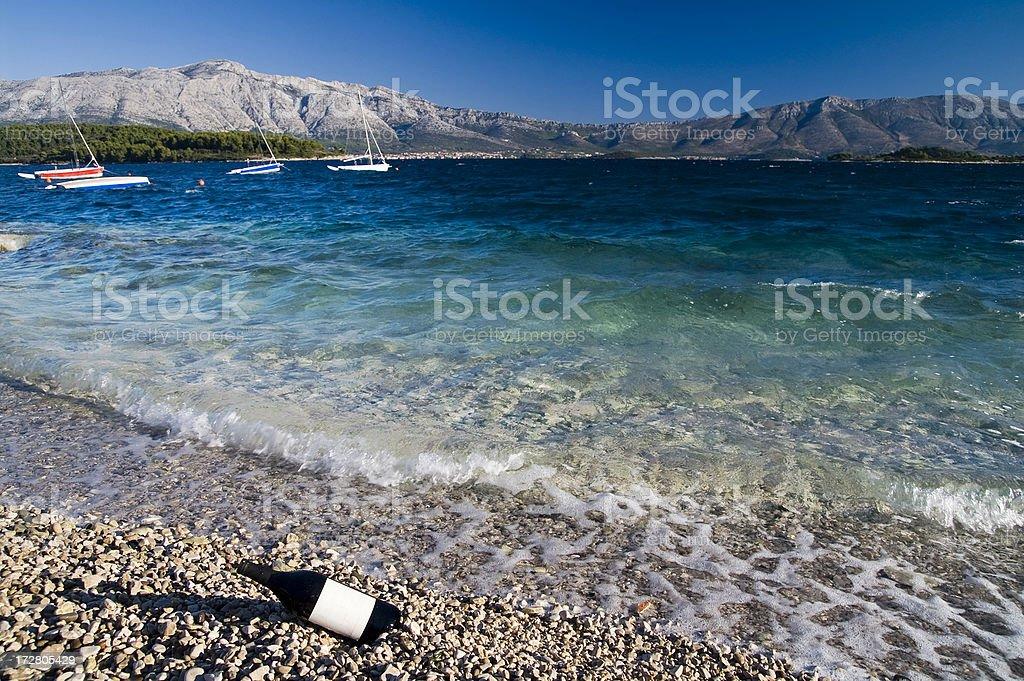 Wine bottle on the beach. Croatia royalty-free stock photo