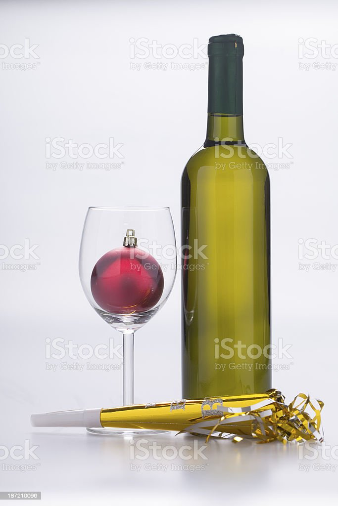 wine bottle, trumpet and christmas ornament royalty-free stock photo