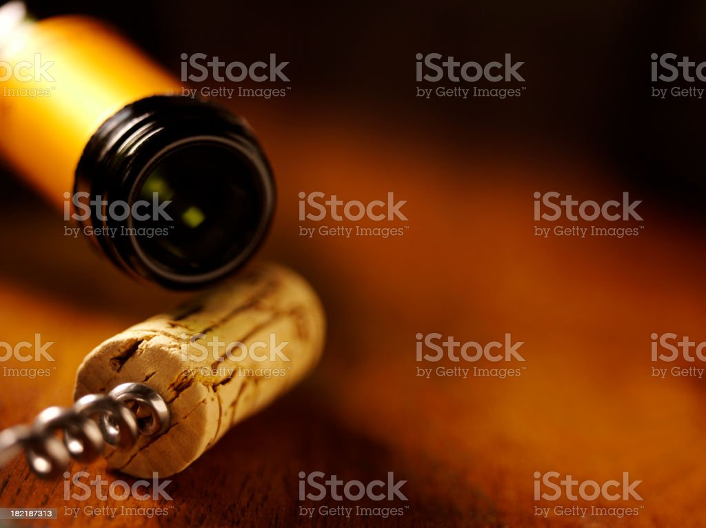 Wine Bottle,Cork and Opener on a Table royalty-free stock photo