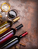 wine bottles and glass on table with copy space, background