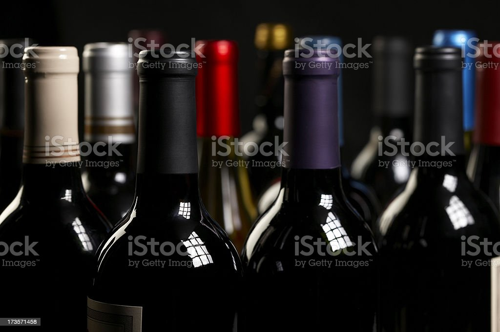 Wine bottles close up on black royalty-free stock photo