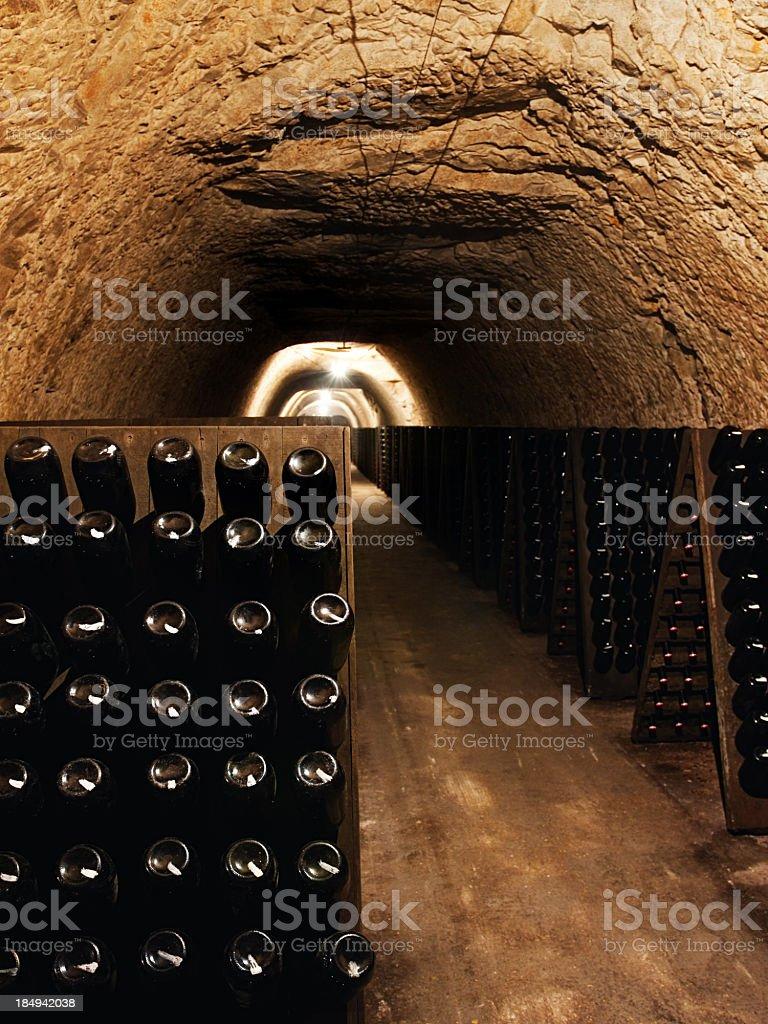 Wine bottles in a cellar stock photo
