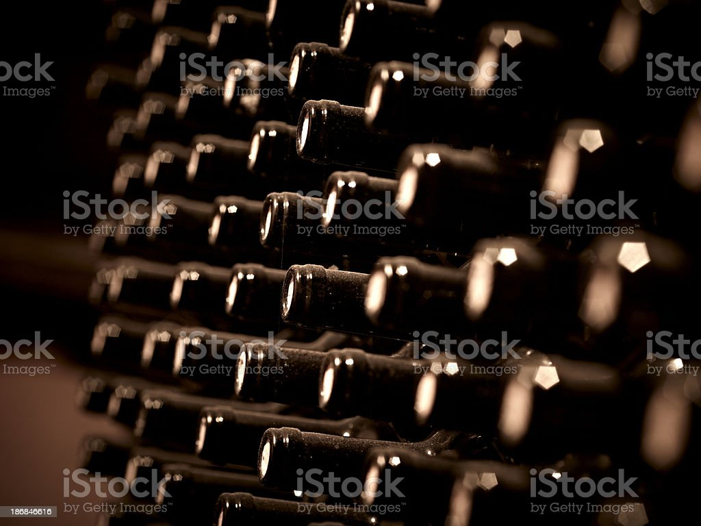 Wine bottles in a cellar stock photo