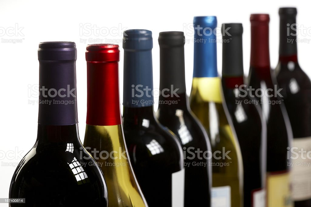 Wine bottles in a row on white horizontal royalty-free stock photo