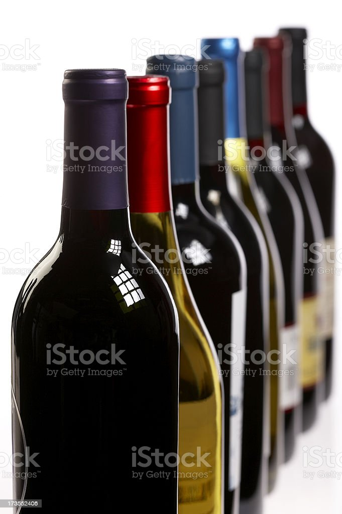 Wine bottles in a row on white royalty-free stock photo