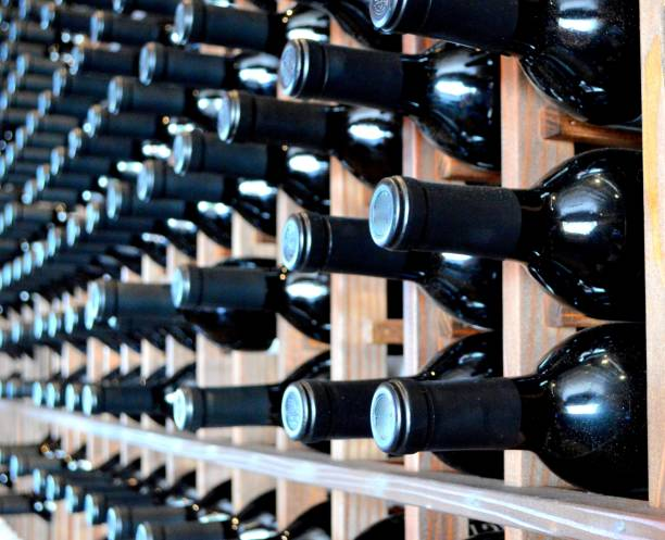 Wine bottles in a row stock photo