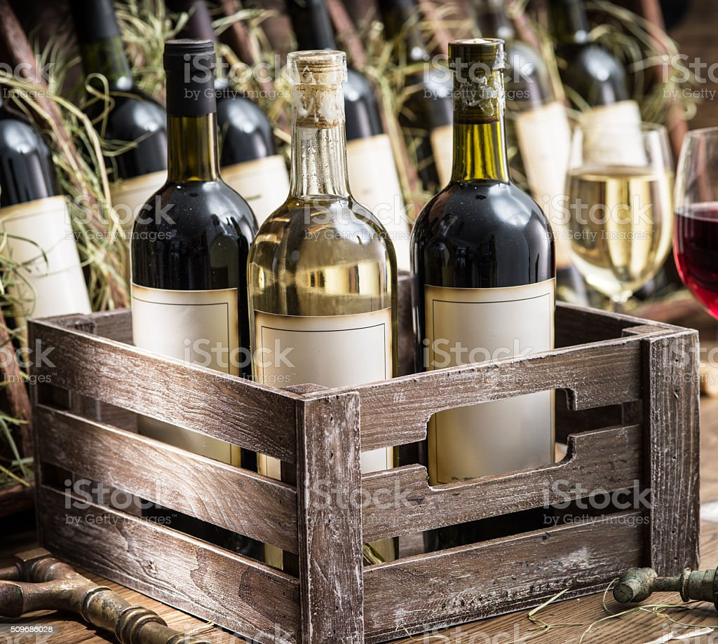 Wine bottles in a wooden crate . stock photo