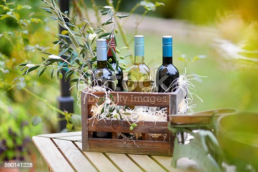 istock Wine bottles in a wooden crate 590141228