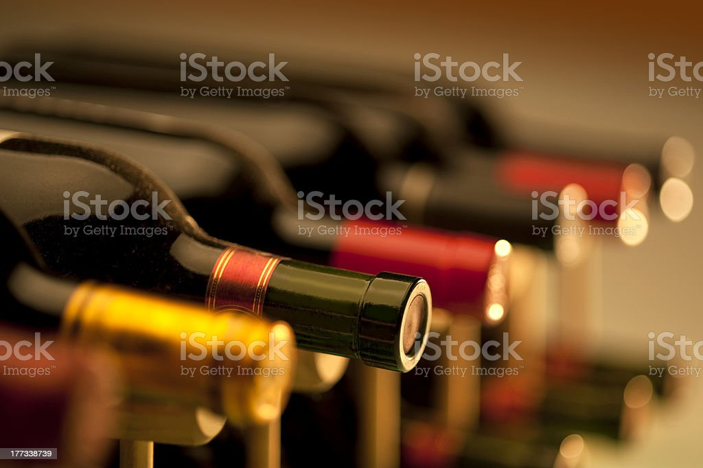 Wine Bottles in Cellar stock photo