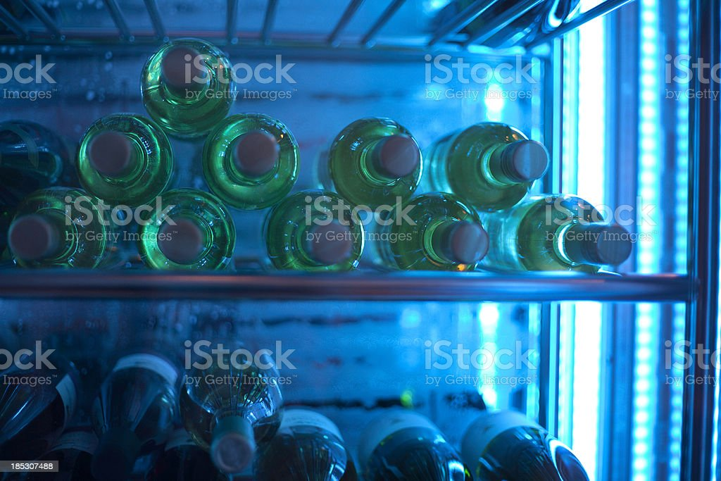 Wine bottles in chiller royalty-free stock photo