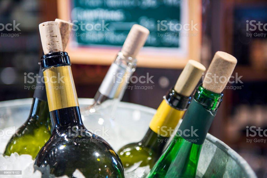 Wine bottles in ice bucket in Madrid, Spain stock photo