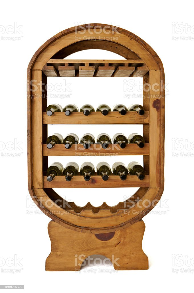 Wine bottles in large freestanding wooden rack on white background stock photo
