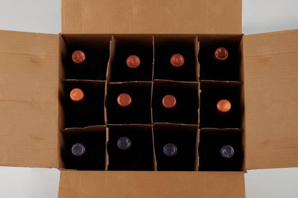 vin flaskor i öppet fodral - wine box bildbanksfoton och bilder