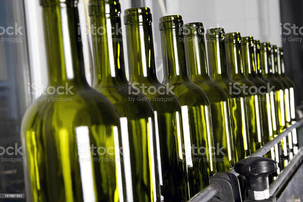 Wine bottles in production line royalty-free stock photo