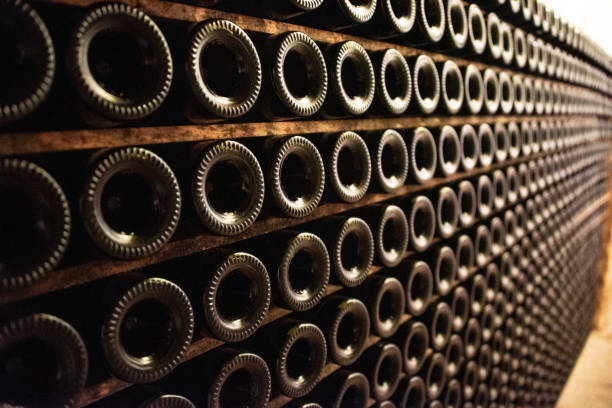 Wine bottles in rows A large amount of wine bottles in rows merlot grape stock pictures, royalty-free photos & images