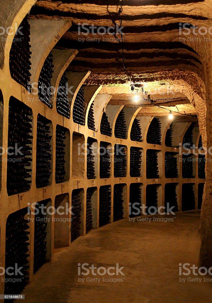 Wine bottles in the cellar stock photo