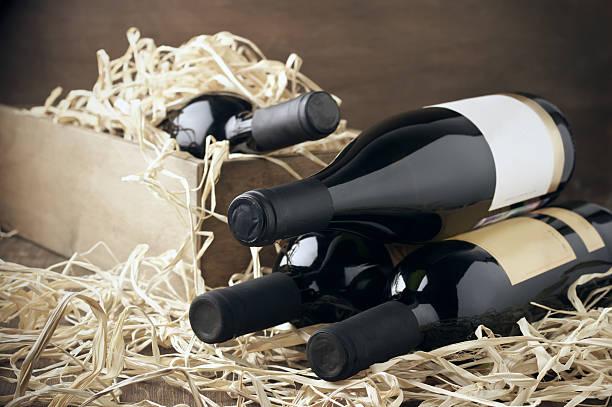 wine bottles in wooden box and straw - wine box bildbanksfoton och bilder