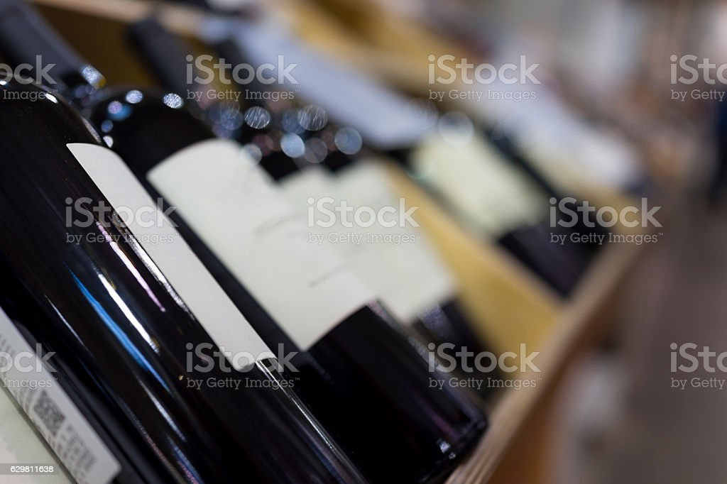 Wine bottles in wooden crates on display stock photo