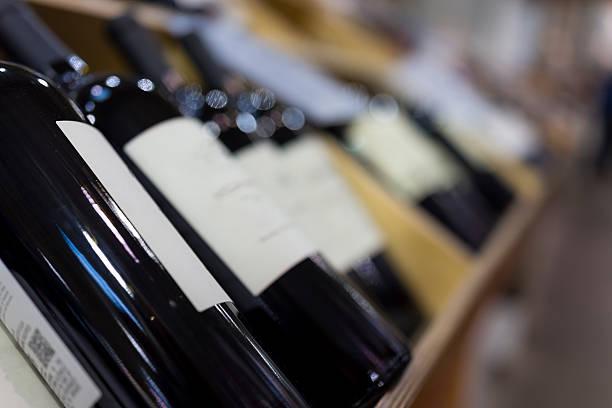 wine bottles in wooden crates on display - wine box bildbanksfoton och bilder