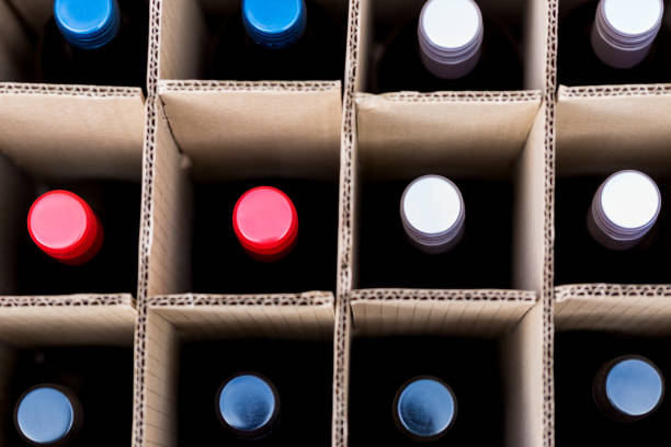Wine bottles of red and white wine in cardboard box stock photo