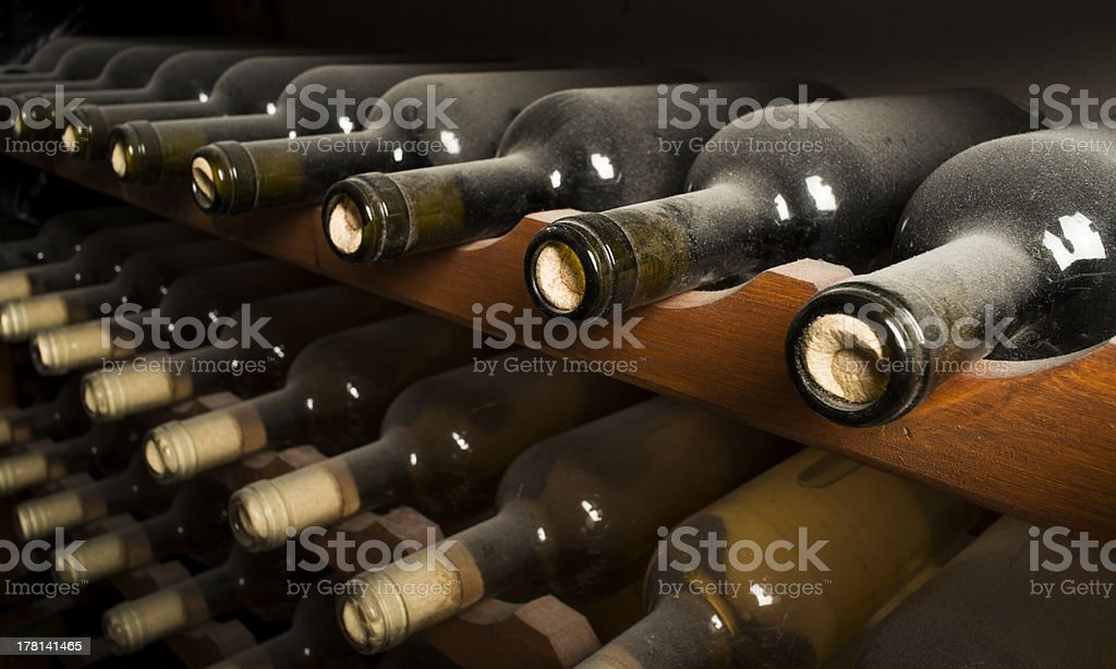 Wine bottles on shelf royalty-free stock photo