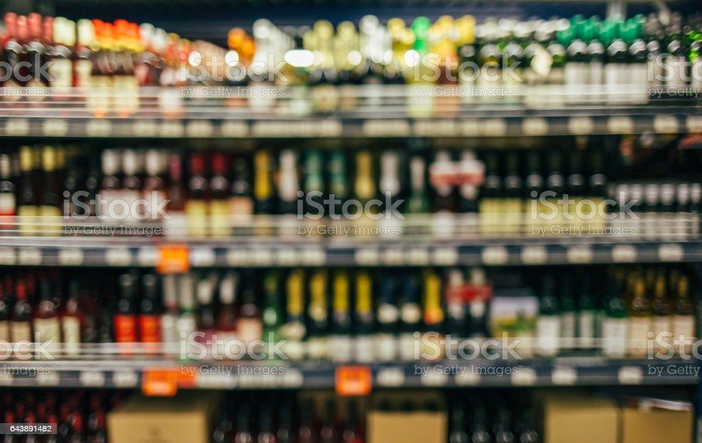 Wine bottles on shelf stock photo