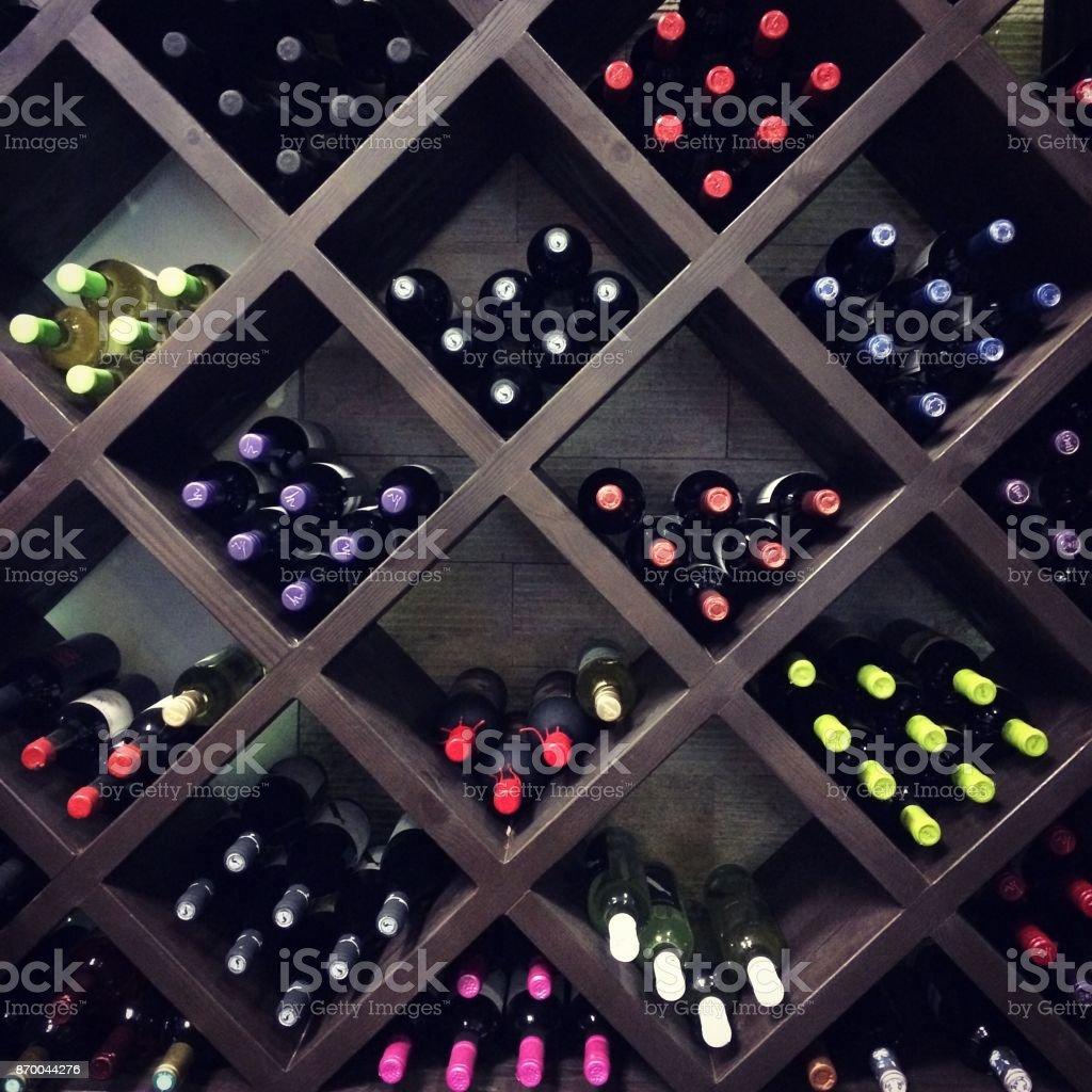 Wine bottles on the shelves stock photo