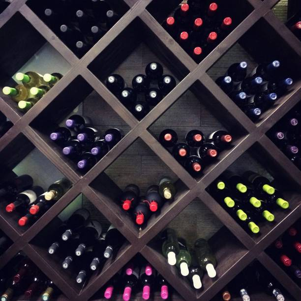 Wine bottles on the shelves Wine bottles on the shelves cellar stock pictures, royalty-free photos & images