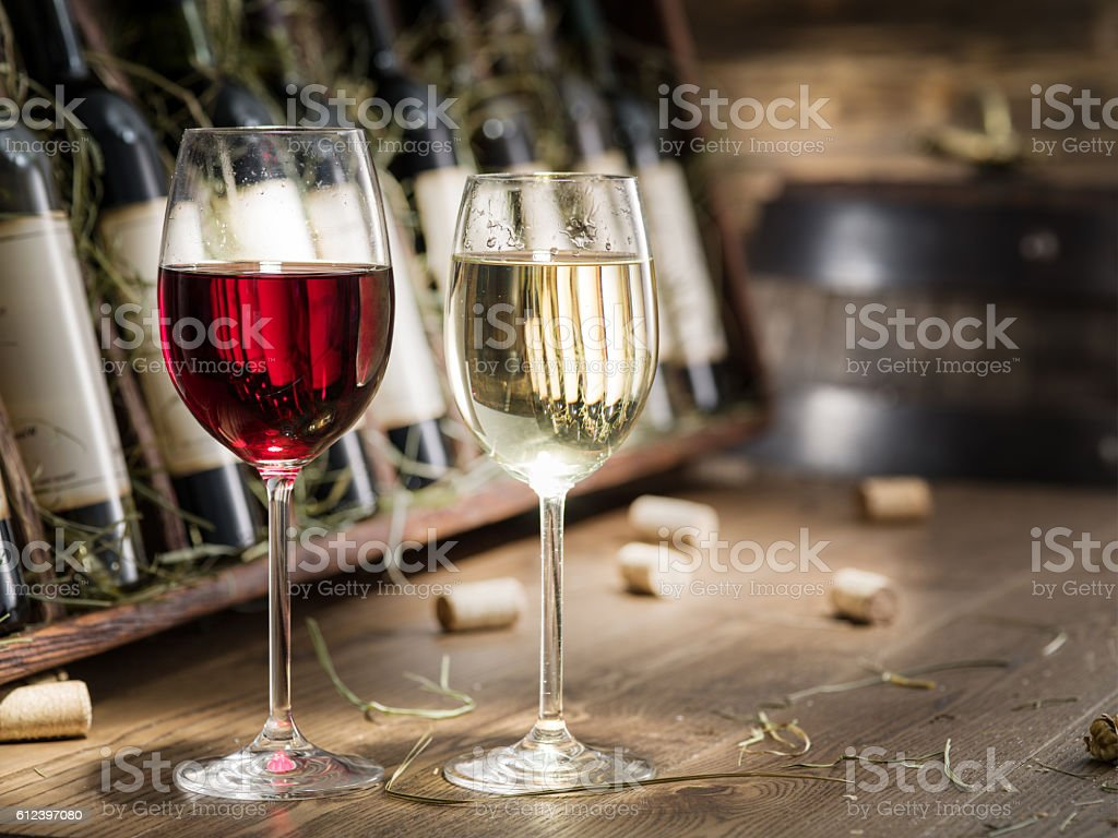Wine bottles on the wooden shelf. stock photo