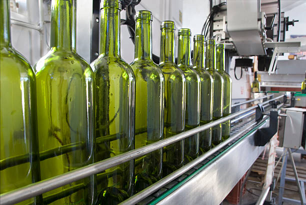 wine bottles - bottling plant stock photos and pictures