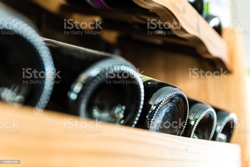 wine bottles with black glass in wooden cellar stock photo