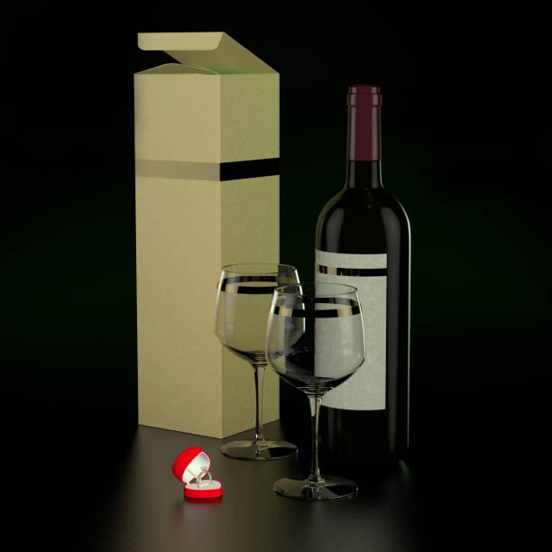 Bouteille de vin, deux verre et anneau de fiançailles - Photo
