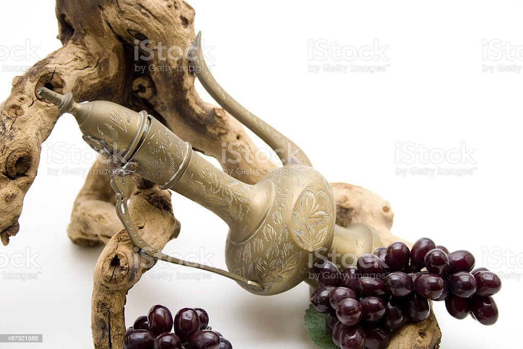Wine carafes with grapes and vine stock photo