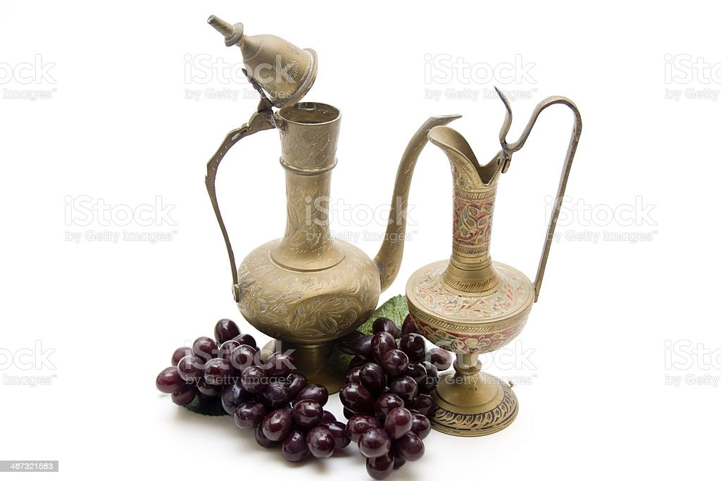 Wine carafes with grapes stock photo