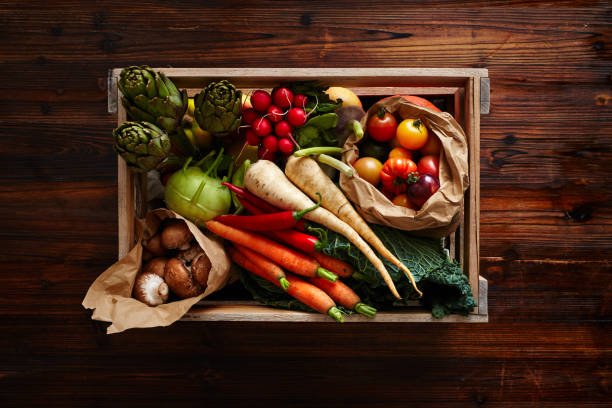 wine case filled with variety of vegetables stock photo