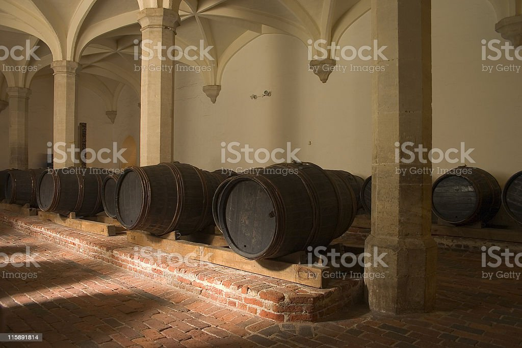 Wine casks in cellar stock photo