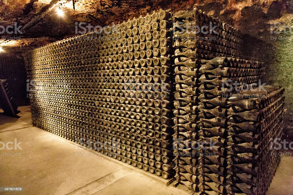 Wine cellar bottles of Cava or Champaign at a Bodega stock photo
