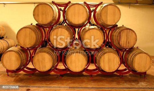 modern wine cellar full of wine barrels