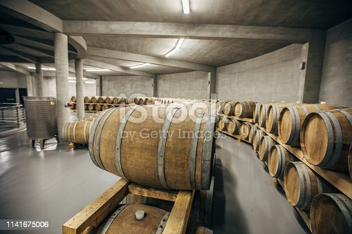 Inside of wine cellar, cellar is full of wooden casks, no people.