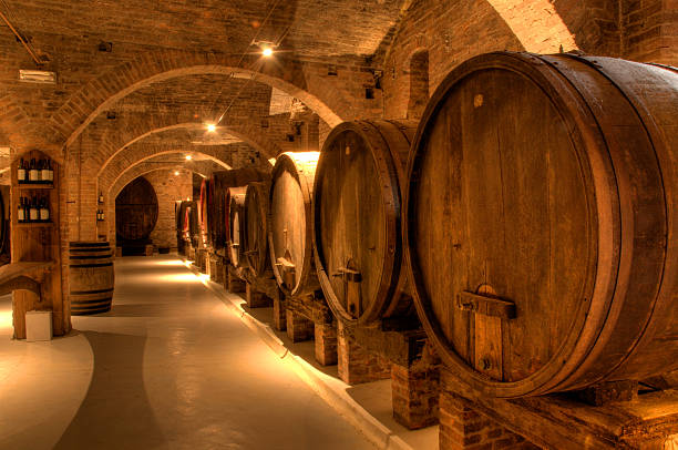 Wine cellar Wine cellar in ancient building in Tuscany, Italy cellar stock pictures, royalty-free photos & images