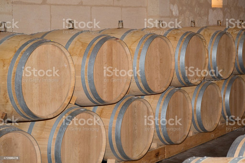 Wine cellar with barrels in stacks stock photo